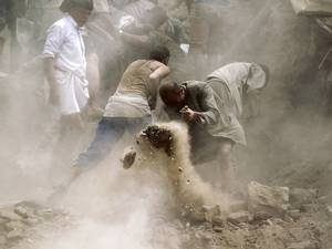 12 June 2015: Yemenis search for survivors under the rubble of houses in the UNESCO-listed heritage site in the old city of Yemeni capital Sanaa, following an overnight Saudi-led air strike