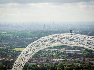 James Kingston admires the view at the summit of the iconic arch