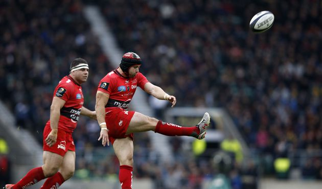 Toulon's Welsh fullback Leigh Halfpenny (R) kicks the ball during the European Rugby Champions Cup rugby union final match between Clermont and Toulon at Twickenham Stadium, south west of London on May 2, 2015.   AFP PHOTO / ADRIAN DENNISADRIAN DENNIS/AFP/Getty Images