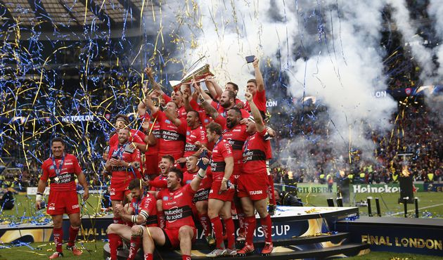 The Toulon rugby team celebrate with the trophy after they won 24-18 during the European Rugby Champions Cup rugby union final match between Clermont and Toulon at Twickenham Stadium, south west of London on May 2, 2015.  AFP PHOTO / ADRIAN DENNISADRIAN DENNIS/AFP/Getty Images