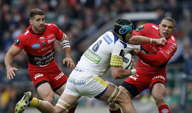 Clermont's French flanker Julien Bonnaire (2nd R) is challenged by Toulon's South African winger Bryan Habana (R) during the European Rugby Champions Cup rugby union final match between Clermont and Toulon at Twickenham Stadium, south west of London on May 2, 2015.   AFP PHOTO / ADRIAN DENNISADRIAN DENNIS/AFP/Getty Images