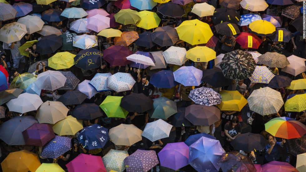 "People open umbrellas at the main protest site in Hong Kong on Tuesday, October 28. The umbrella has become <a href=""http://www.cnn.com/2014/09/30/world/asia/objects-hong-kong-protest/index.html"">the defining image of the protest movement,</a> used to shield protesters from tear gas and the elements."
