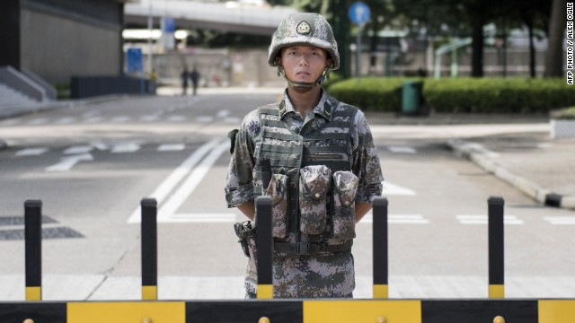 A Chinese soldier stands guard at the entrance to the headquarters of the PLA's Hong Kong garrison on August 29.