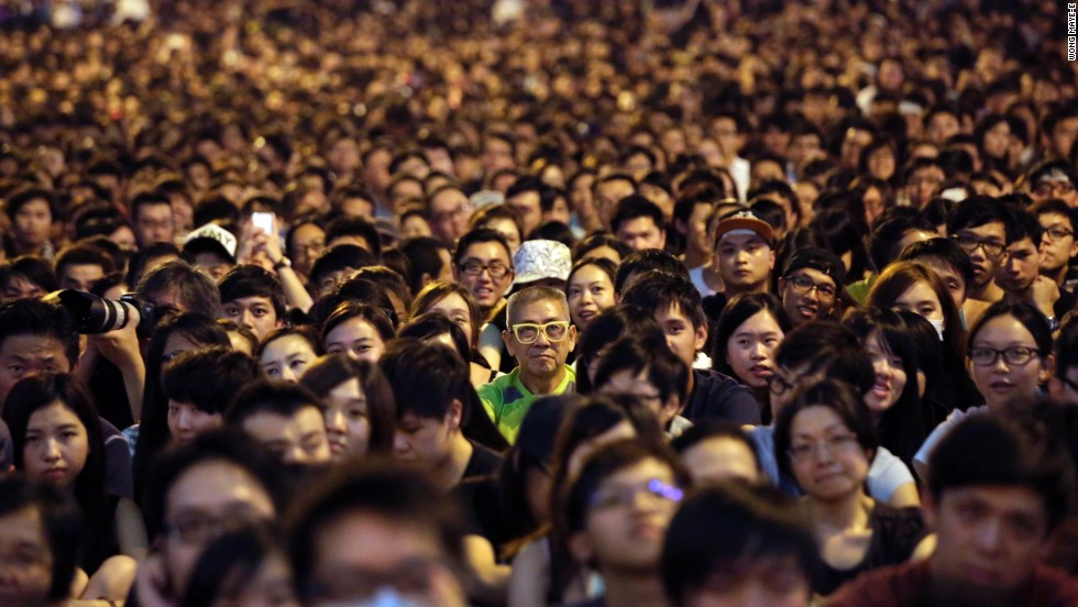Thousands of pro-democracy activists attend a rally on the streets near government headquarters on October 4 in Hong Kong.