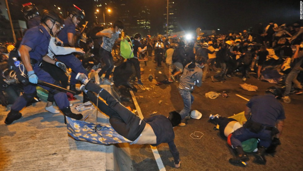 Hundreds of pro-democracy protesters face off with Hong Kong police on November 30.