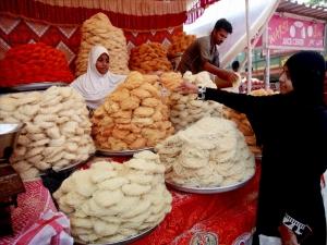 A girl purchases Sutarfeni (Sweet vermicelli) ahead of Eid festival in Mumbai...