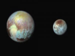 Combination image released by NASA shows Pluto ( left) and its moon Charon...