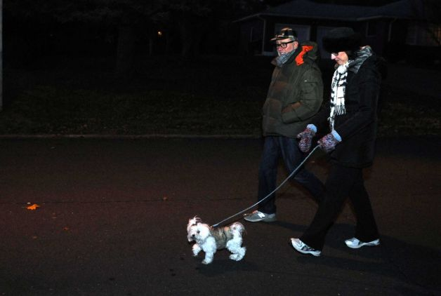 Barbara and Michael Evanko walk their dog down Judith Terrace in Stratford Tuesday, Nov. 18, 2014. The couple walks their dog nightly past 75 Judith Terrace where a woman was recently attacked by her pet dog and died from her injuries. Photo: Autumn Driscoll / Connecticut Post