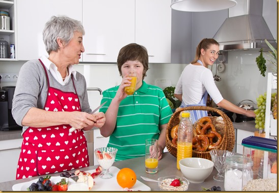 Three generations living together - happy family cooking together.