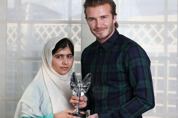 Proud: David Beckham presents a Mirror Pride of Britain award to Malala Yousafzai