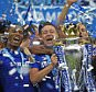 """Chelsea's John Terry celebrates with the trophy and team mates after winning the Barclays Premier League.\nFootball - Chelsea v Sunderland - Barclays Premier League - Stamford Bridge - 24/5/15\n  Reuters / Dylan Martinez\n Livepic\n EDITORIAL USE ONLY. No use with unauthorized audio, video, data, fixture lists, club/league logos or """"live"""" services. Online in-match use limited to 45 images, no video emulation. No use in betting, games or single club/league/player publications.  Please contact your account representative for further details."""