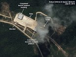 This image provided by the U.S.-Korea Institute at the Johns Hopkins School of Advanced International Studies via 38 North and via a satellite image from  Centre National dí&tudes Spatiales,  shows a satellite image dated July 21, 2015, showing recently completed construction at Sohae, North Koreaís main rocket launch site. South Korea is concerned the North could conduct a launch in October to mark the 70th anniversary of the ruling communist party.  The U.S.-Korea Institute at the Johns Hopkins School of Advanced International Studies says the image shows a support building for rocket assembly and a moveable platform on rails that could be used to move a rocket to the launch pad, which is partially obscured by clouds in the image.  (Centre National dí&tudes Spatiales/38 North/Johns Hopkins School of Advanced International Studies via AP)
