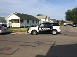 FBI and police vehicles remain near house on Olcott in Lackawanna where search warrants executed today