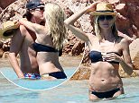 27.JULY.2015 - SARDINIA - ITALY\n***EXCLUSIVE PICTURES*** \n*AVAILABLE FOR UK SALE ONLY*\nMODEL HEIDI KLUM SHOWS OFF HER BIKINI BODY WHILE CELEBRATING BOYFRIENDS VITO SCHNABEL BIRTHDAY WHILE ON HOLIDAY IN SARDINIA, THE LOVED UP COUPLE ARE PICTURED ENJOYING EACHOTHERS COMPANY AS THEY TAKE A DIP IN THE CLEAR BLUE SEA AND RELAX ON THE BEACH WITH BEERS!\nBYLINE MUST READ : CIAO PIX/XPOSUREPHOTOS.COM\n***UK CLIENTS - PICTURES CONTAINING CHILDREN PLEASE PIXELATE FACE PRIOR TO PUBLICATION ***\n*UK CLIENTS MUST CALL PRIOR TO TV OR ONLINE USAGE PLEASE TELEPHONE 0208 344 2007**