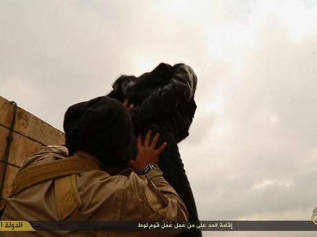 The two men can be seen at the top of a tower reported to be in Nineveh, Iraq