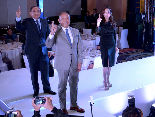 In photo are from (L-R) Globe executive vice president and chief operating officer Gil Genio, Globe president and CEO Ernest Cu, and Globe senior vice president for consumer mobile marketing Issa Cabreira