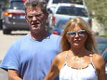Brentwood, CA - Goldie Hawn and Kurt Russell check out the progression of their homes construction in Brentwood, California. Kurt looked clean cut and fresh shaven, unlike what we are used to seeing the star as of lately wearing long hair and a bushy mustache, as walked along side his lovely wife Goldie shielding her from a car backing up.    AKM-GSI    August 11, 2015   To License These Photos, Please Contact : Steve Ginsburg (310) 505-8447 (323) 423-9397 steve@akmgsi.com sales@akmgsi.com or Maria Buda (917) 242-1505 mbuda@akmgsi.com ginsburgspalyinc@gmail.com