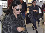 EXC Demi Lovato greets fans while leaving Sydney 3.JPG