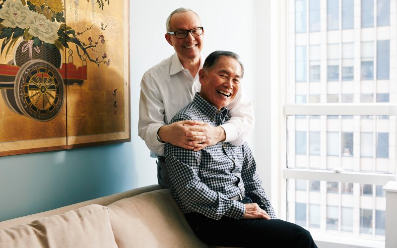 """The actor George Takei, foreground, with his husband, Brad Takei, at their apartment in New York, May 13, 2014. For Takei of """"Star Trek"""" fame, coming out as gay was just the start of a new persona."""