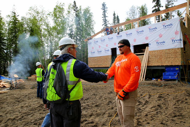 Galena, AK, June 12, 2014--  FEMA Region 10 Administrator Ken Murphy (L) greets Samaritans Purse Volunteer Keith Smith as they inspect the building of Cold Climate Homes for the disaster survivors whom are eigible for FEMA assistance. Each one of the homes will take approximately 8 weeks to complete and are being built concurrently by volunteers from Samaritans Purse and United Methodist Volunteers in Mission, while FEMA pays for materials and shipping. Adam DuBrowa/ FEMA