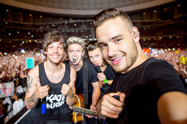 Louis Tomlinson, Niall Horan, Harry Styles and Liam Payne of One Direction photographed onstage in 2015