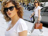 """51823923 Singer/actress Jennifer Lopez steps out in New York City on August 14, 2015. Jennifer recently made one of her fan's dreams come true when she not only followed him on Instagram, but posted a picture of the hand-written note the fan sent her with a caption, """"Ok."""" FameFlynet, Inc - Beverly Hills, CA, USA - +1 (818) 307-4813 RESTRICTIONS APPLY: USA ONLY"""