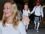 Sunday, August 16, 2015 - Iggy Azalea is all smiles as she leaves LA with fiance NBA star Nick Young.  The pop star recently admitted to a host of plastic surgery - breast implants and a nose job.  It looks like she may have had lip fillers and a chin implant as well ... Iggy showed off her engagement ring and what looks like some serious psoriasis on her knuckles.  Ouch!\nJuliano/X17online.com