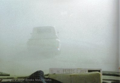 Truck, barely visible through dust storm.