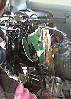 Black and green BMW motorcycle in van.