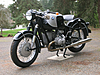 1965 R60 BMW Motorcycle painted black with silver panels and pure white pinstripes