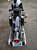 Rear shot of 1965 R60 BMW Motorcycle painted black with silver panels
