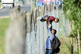 Migrants leave a migrant reception centre in Roszke, Hungary