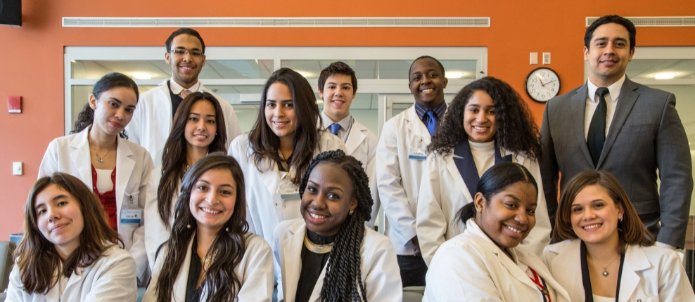 Group of students in white coats and administrator