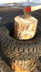 Here, a tire is mounted to the splitting block to contain the split firewood and keep the wood upright.  Photos by Brett McLeod.