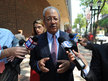 U.S. Rep. Chaka Fattah is swarmed by the media as he leaves the U.S. Federal Courthouse in Philadelphia after being arraigned on corruption charges. (CLEM MURRAY/Staff Photographer)