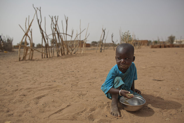 """<span class='image-component__caption' itemprop=""""caption"""">2-year-old Aliou Seyni Diallo eats dry couscous given to him by a neighbor, after he collapsed in tears of hunger in the village of Goudoude Diobe, in the Matam region of northeastern Senegal, Tuesday, May 1, 2012.</span>"""