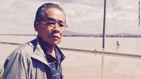 Business owner Shigeru Kikuchi was stranded when his car broke down while trying to drive along flooded streets.