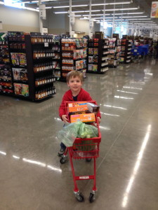 Pint-sized volunteer at our Scavenger Hunt Food Drive. He loved collecting food for other kids!