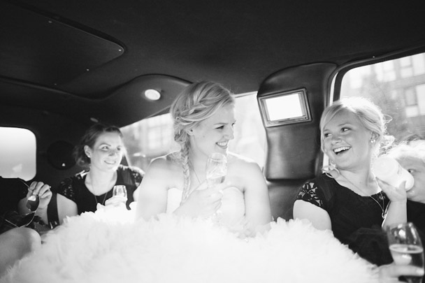 bride in limo after ceremony