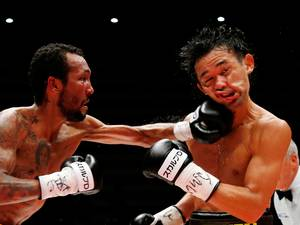22 September 2015: Japanese champion Shinsuke Yamanaka, right, gets a punch from Panama's challenger Anselmo Moreno in the eighth round of their WBC bantamweight boxing title match in Tokyo, Japan. Yamanaka defended his title by a 2-1 decision