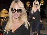 Pamela Anderson is all smiles as she arrives at her hotel in Berlin with one of her German managers Florian Wess. She is in Berlin to promote her new book.  Pictured: Pamela Anderson Ref: SPL1133964  240915   Picture by: Splash News  Splash News and Pictures Los Angeles: 310-821-2666 New York: 212-619-2666 London: 870-934-2666 photodesk@splashnews.com