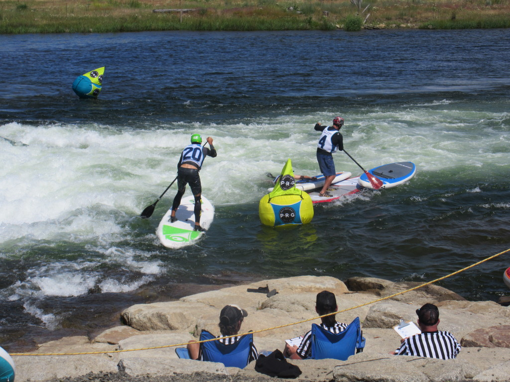 Runaway boards and swimming paddlers were common in the SUP Cross heats.