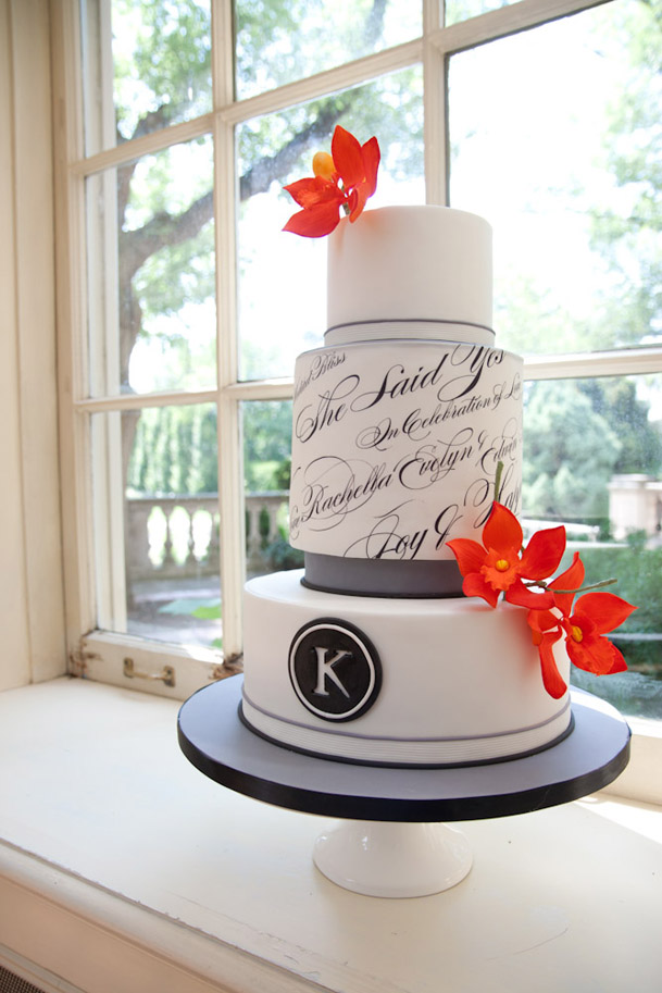 black white calligraphy cake with orange accents