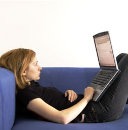 Women with laptop choosing immigration consultants