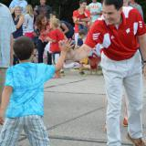 Governor Walker high-fives residents at the Menomonee Falls 4th of July parade.  7/3/14