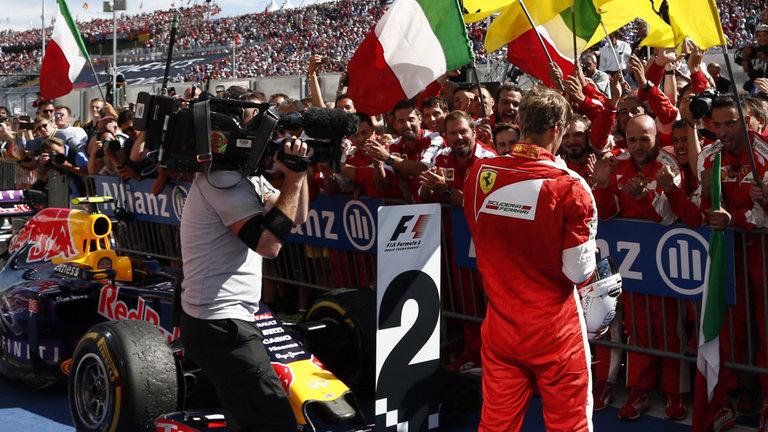 Race winner Sebastian Vettel celebrates in parc ferme