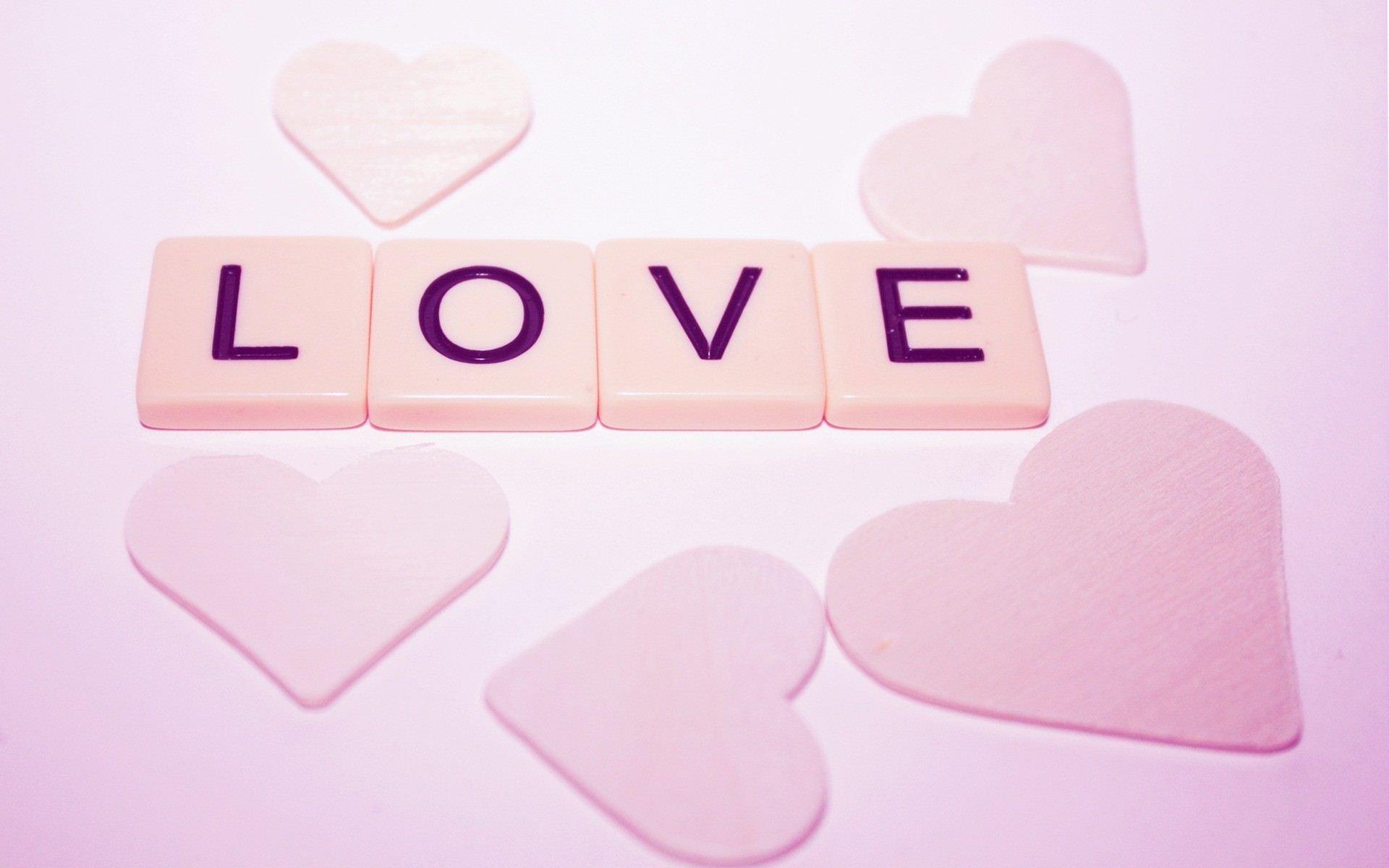 淡粉色的LOVE爱心糖果 动态ppt背景图片