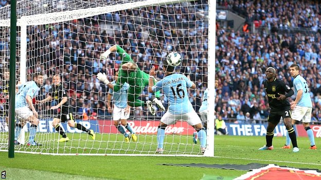 Ben Watson scores for Wigan against Manchester City in the FA Cup final