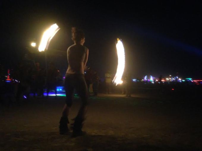 Fire Dancer performs out on the playa at Black Rock City.
