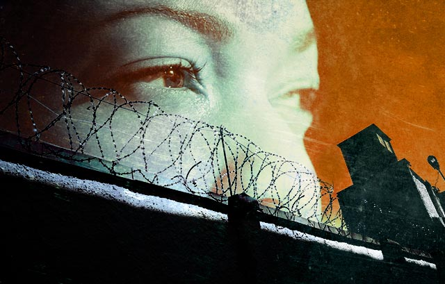 Women's eyes looking over prison fence
